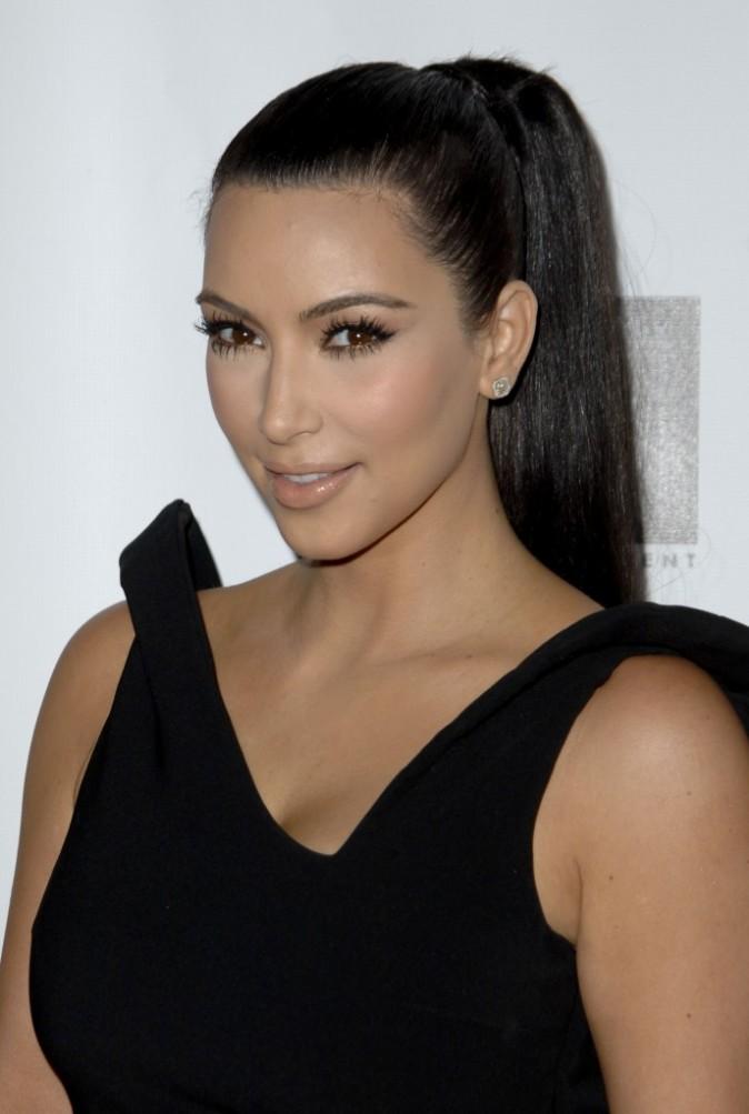 Juillet 2011 : des cheveux tirés à quatre épingles