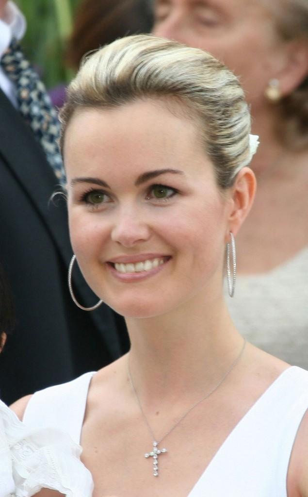 Coiffure de star : le chignon bas de Laeticia Hallyday en 2005 au baptême de Jade