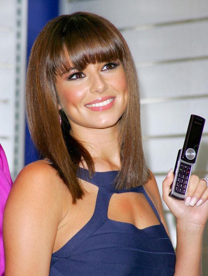 Coiffure de Cheryl Cole en octobre 2007 : elle adopte la frange sur carré lissé !