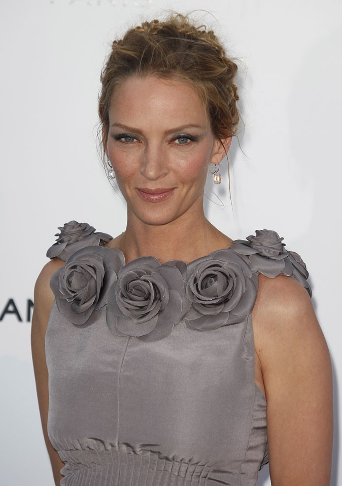 Coiffure de star au Festival de Cannes 2011 : le chignon tressé d'Uma Thurman