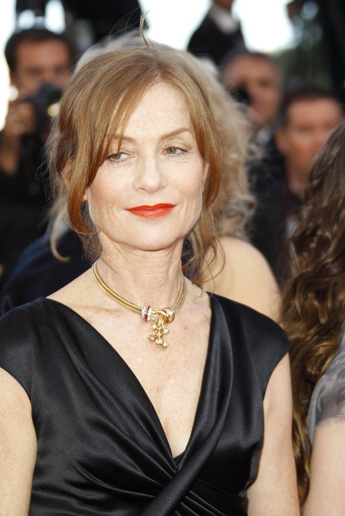 Maquillage de star au Festival de Cannes 2011 : le rouge à lèvres orange d'Isabelle Huppert