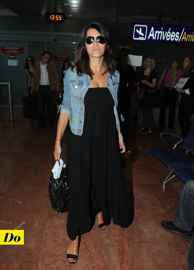 Look de star : la robe longue noire de Karine Ferri