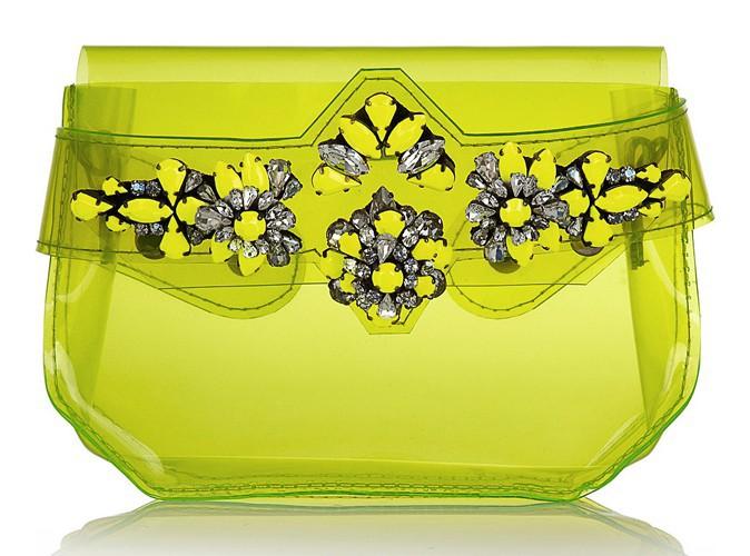 Pochette en PVC fluo ornée de cristaux transparents, Shourouk, 660 €.