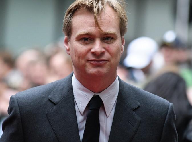 """Christopher Nolan : le réalisateur de The Dark Knight Rises dénonce """"une tragédie absurde"""""""