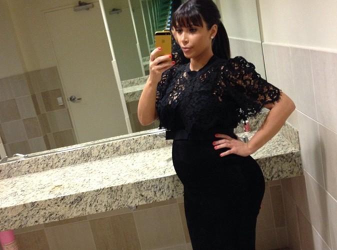 http://cdn1-public.ladmedia.fr/var/public/storage/images/news/kim-kardashian-elle-affiche-un-baby-bump-decomplexe-385933/4844740-1-fre-FR/Kim-Kardashian-elle-affiche-un-baby-bump-decomplexe-!_portrait_w674.jpg