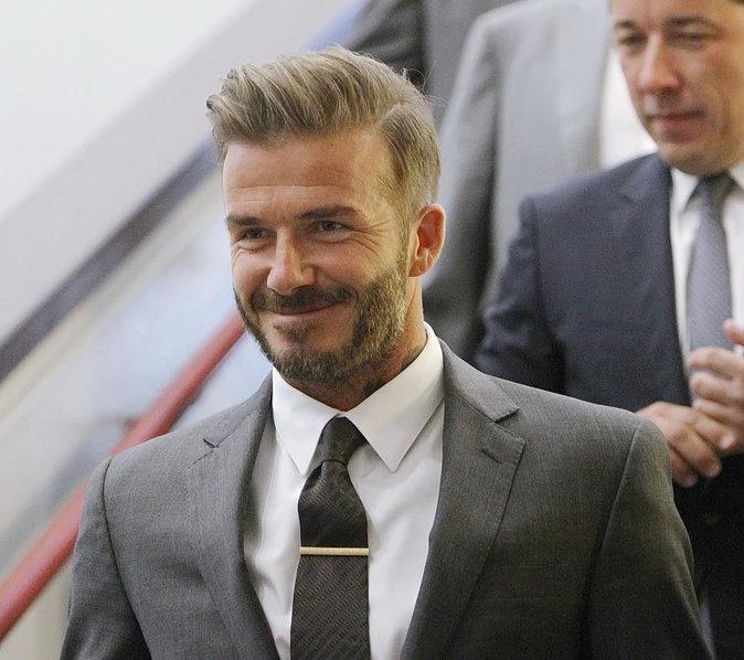 David Beckham tout sourire pose pour les photographes
