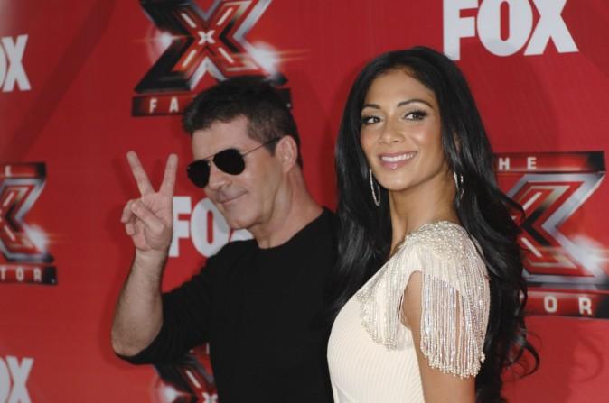 Nicole Scherzinger et Simon Cowell lors de la conférence de presse du X-Factor US à Los Angeles, le 19 décembre 2011.