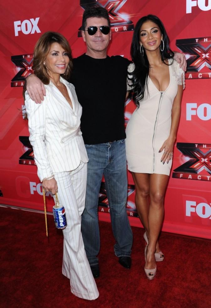 Nicole Scherzinger, Simon Cowell et Paula Abdul lors de la conférence de presse du X-Factor US à Los Angeles, le 19 décembre 2011.