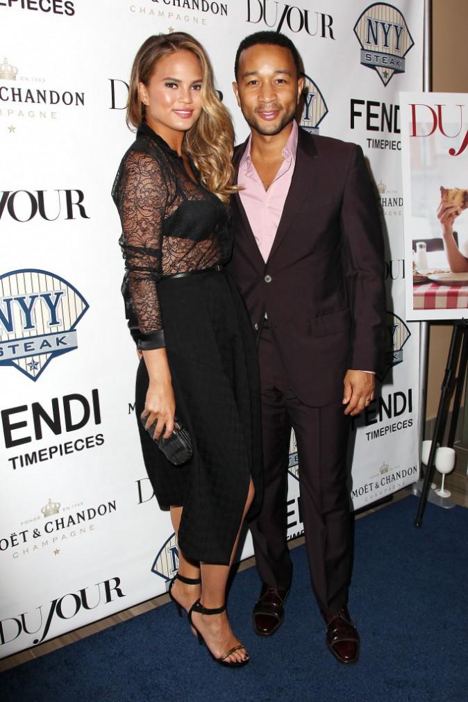 Chrissy Teigen et John Legend étaient à l'événement organisé par le magazine Dujour et le NYY Steak le lundi 28 juillet 2014.