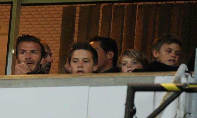 David Beckham et ses trois fils lors d'un match de Manchester United, à Londres