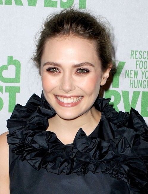 "Elizabeth Olsen lors de la soirée ""An Evening of Practical Magic"" à New York, le 13 avril 2013."