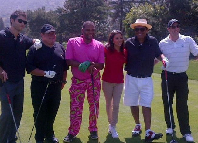 Avec tous ses partenaires de golf !