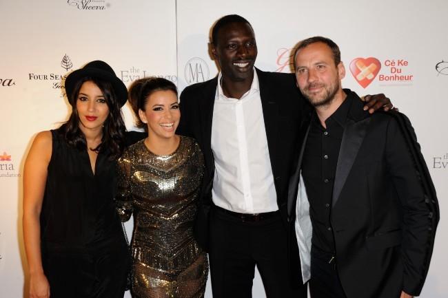 Leila Bekhti, Eva Longoria, Omar Sy et Fred Testot lors du Global Gift Gala à Paris, le 28 mai 2012.
