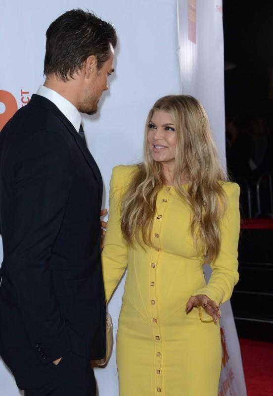 """Josh Duhamel et Fergie lors de l'événement """"TrevorLIVE LA"""" à Hollywood, le 8 décembre 2013."""