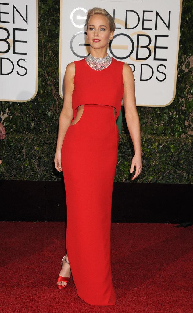 Jennifer Lawrence se la joue glamour pendant les céméronies