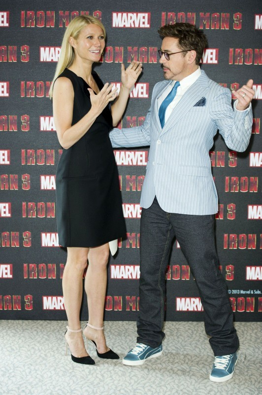 Gwyneth Paltrow et Robert Downey Jr. lors du photocall d'Iron Man 3 à Londres, le 17 avril 2013.