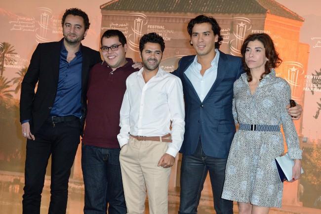"""Jamel Debbouze et ses co-stars lors du photocall du film """"La Marche"""" à Marrakech, le 1er décembre 2013."""