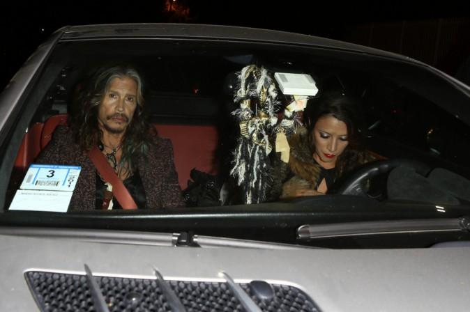 Steven Tyler et sa petite-amie arrivent à la soirée des fiançailles de Johnny Depp et Amber Heard à Los Angeles, le 14 mars 2014.