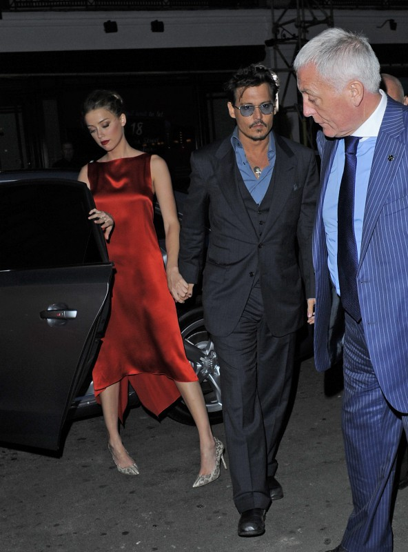 Johnny Depp et Amber Heard à Londres, le 21 juillet 2013.