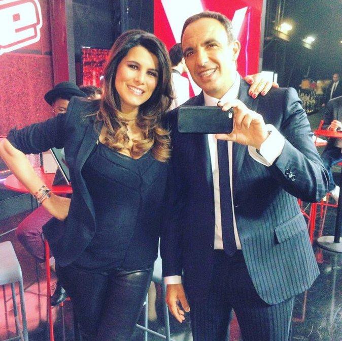 Karine Ferri et Nikos aliagas sur le plateau de The Voice