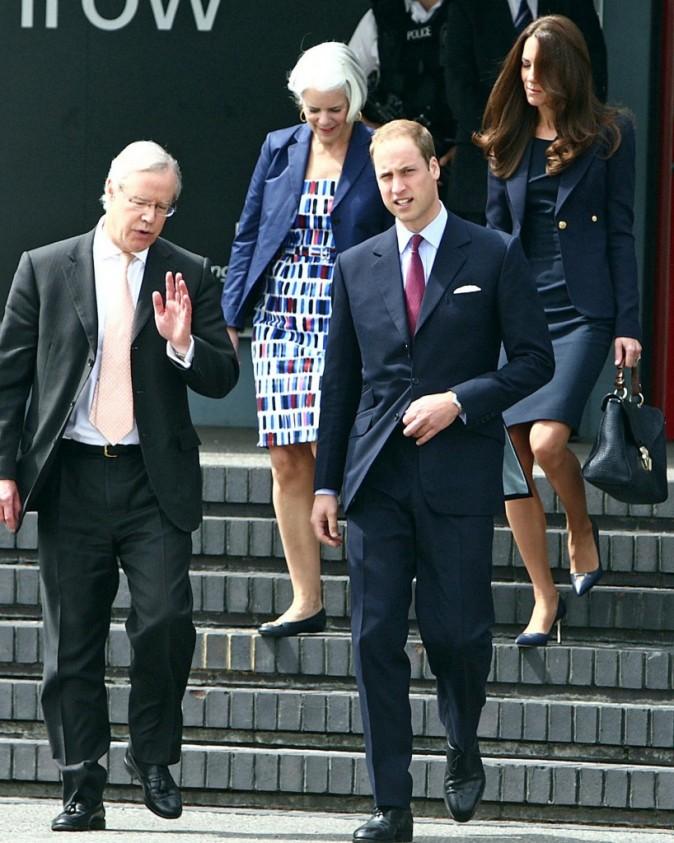 Kate Middleton et le prince William, ainsi que James Wright, à l'aéroport d'Heathrow, le 30 juin 2011.
