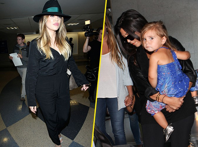 Khloé et Kourtney Kardashian à l'aéroport de Los Angeles le 20 juin 2014