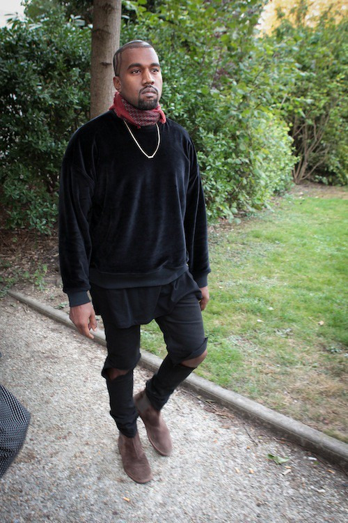 Kanye West arrive au défilé Dries Van Noten à Paris, le 24 septembre 2014
