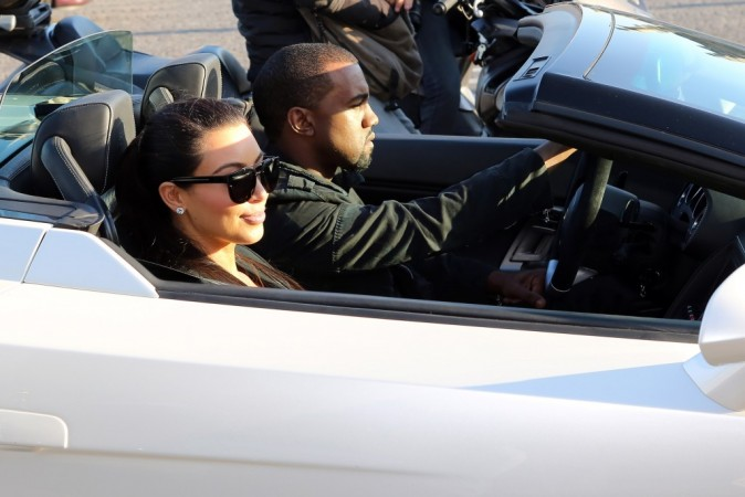 Kim Kardashian et Kanye West se rendant au restaurant Ferdi à Paris, le 17 juin 2012.