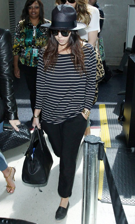 Kourtney Kardashian à l'aéroport de Miami le 13 mars 2014
