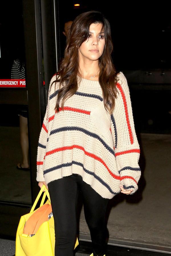 Kourtney Kardashian et Scott Disick à l'aéroport de Los Angeles le 28 septembre 2013