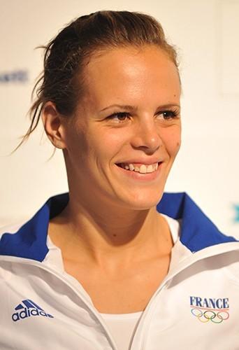 Malgré son échec aux JO, Laure garde le sourire. Pékin en 2008.
