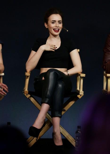 """Lily Collins en promo pour """"The Mortal Instruments : La Cité des ténèbres"""" à Londres, le 19 août 2013."""