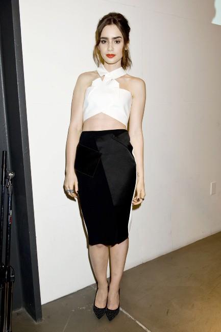 Lily Collins lors de la soirée Flaunt à Los Angeles, le 13 août 2013.