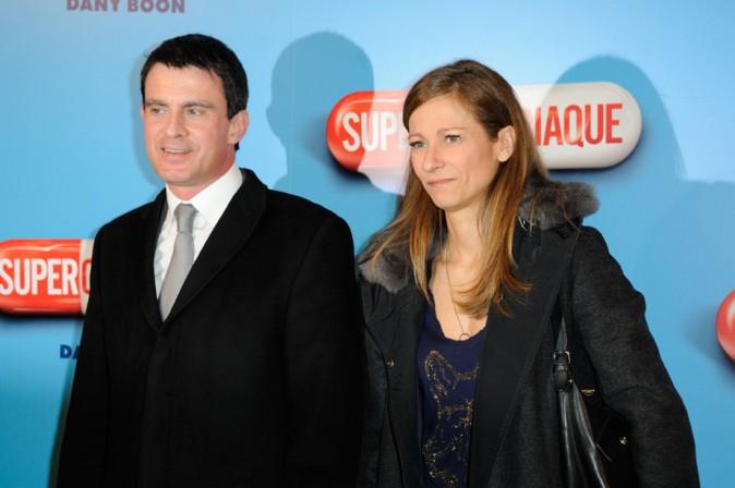 Manuel Valls et sa femme Anne Gravoin à l'avant-première de Supercondriaque organisée à Paris le 24 février 2014