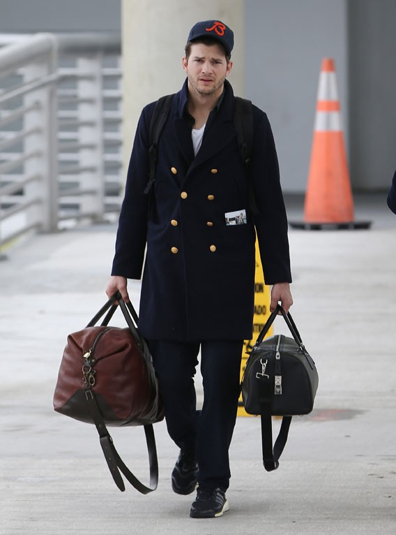 Ashton Kutcher et Mila Kunis à l'aéroport de Jacksonville le 2 février 2014
