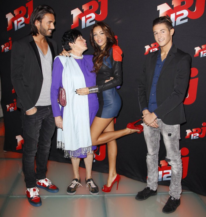 "Thomas Vergara, Livia, Nabilla Benattia et Tarek lors de la conférence de presse de la télé-réalité ""Allo Nabilla"" à Paris, le 21 octobre 2013."