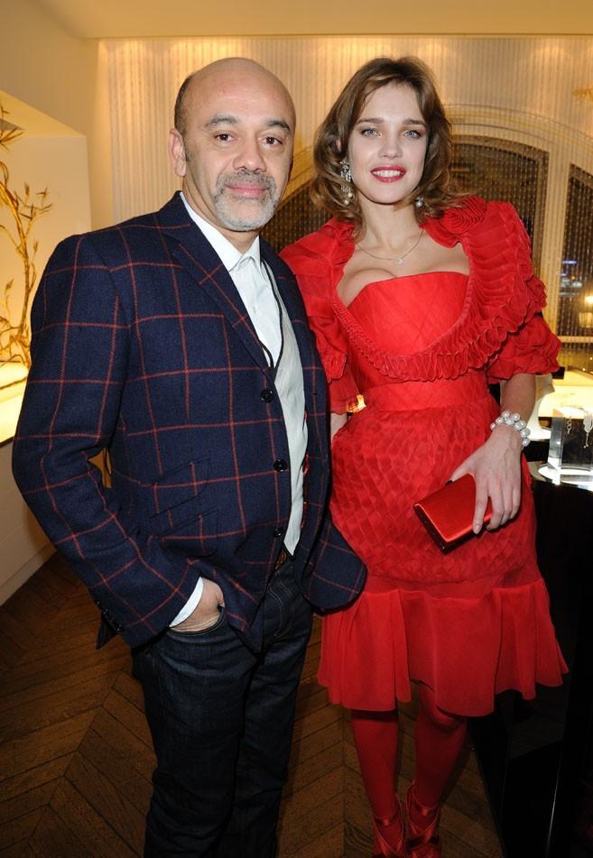 Natalia Vodianova et Christian Louboutin lors de la présentation de la collection de bijoux du top model, à Paris le 15 décembre 2011.