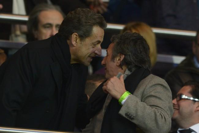 Nicolas Sarkozy et Richard Anconina lors du match entre le PSG et Nice, le 21 avril 2013.