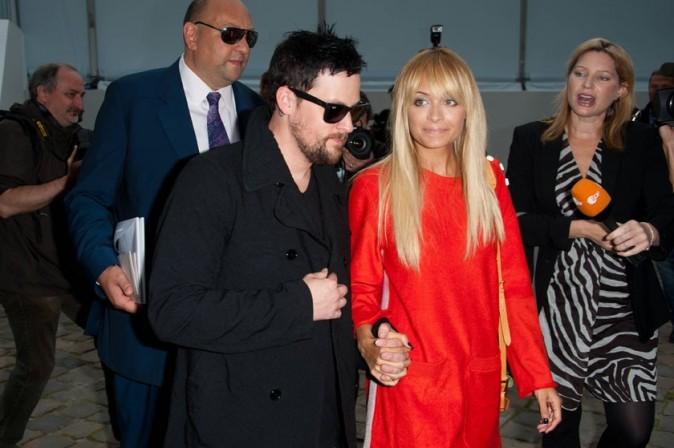 Joel Madden et Nicole Richie se rendant au défilé Louis Vuitton à Paris, le 5 octobre 2011.