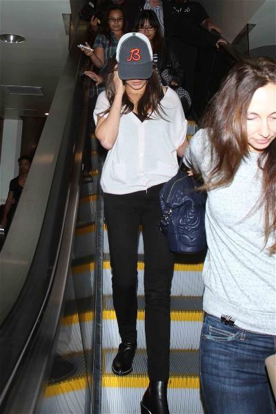 Mila Kunis à l'aéroport de Los Angeles, le 11 septembre 2013.