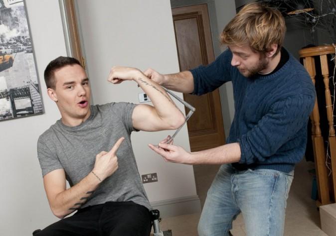 Les One Direction de passage chez Madame Tussaud pour les premières mesures le 11 mars 2013 à Londres