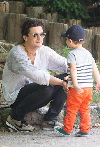 Orlando Bloom et son petit Flynn à New-York le 14 juillet 2013