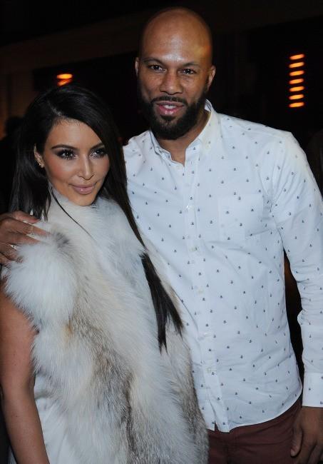 Kim Kardashian et Common lors du défilé Kanye West à Paris, le 6 mars 2012.