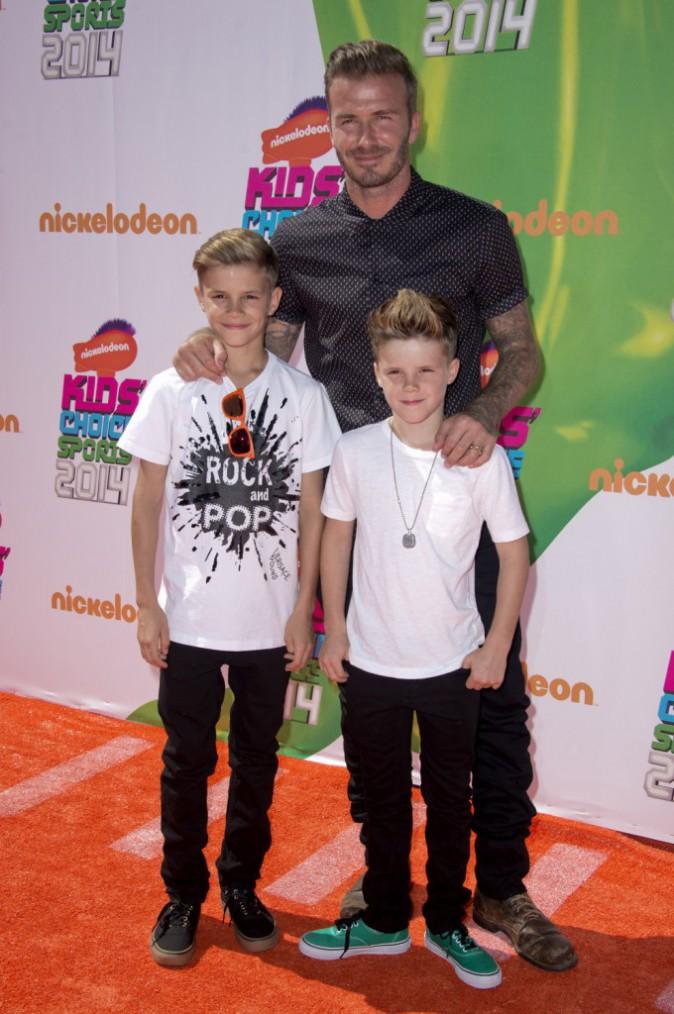 Romeo et Cruz Beckham avec leur père