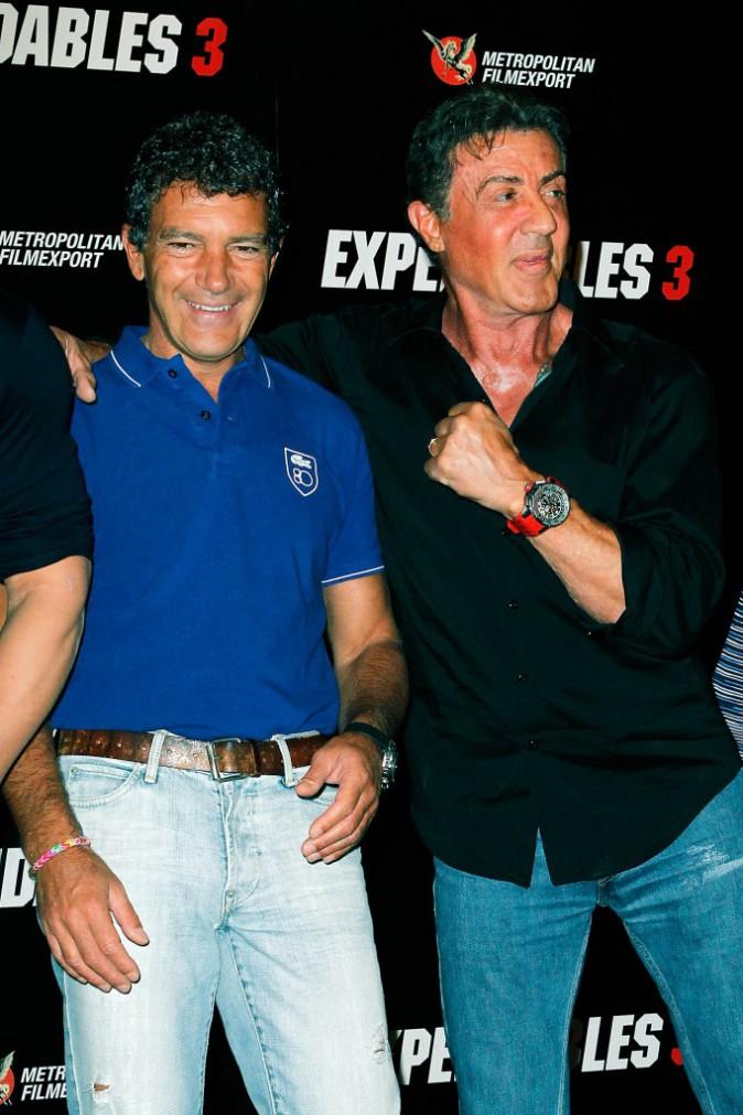 Sylvester Stallone et Antonio Banderas lors du photocall d'Expendables 3 à Paris le 7 août 2014.