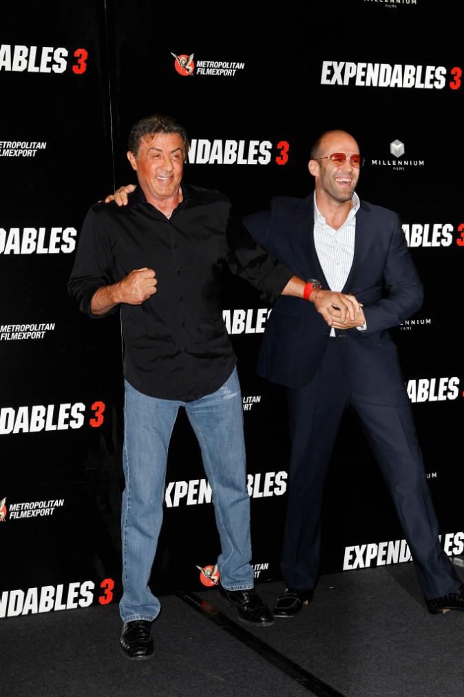 Sylvester Stallone et Jason Statham lors du photocall d'Expendables 3 à Paris le 7 août 2014.