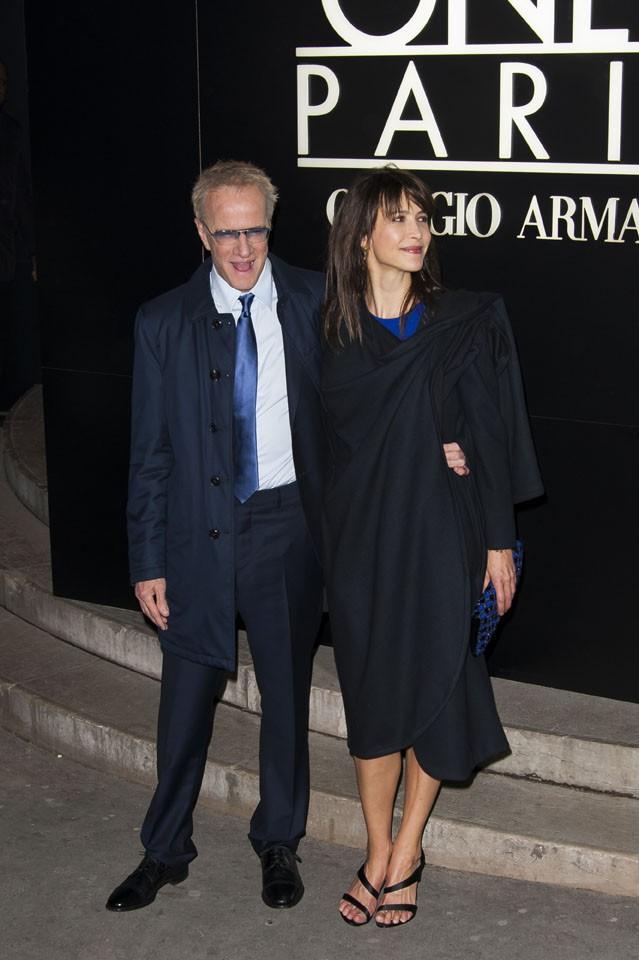 Christophe Lambert et Sophie Marceau au défilé Giorgio Armani organisé au Palais de Tokyo, à Paris, le 21 janvier 2014