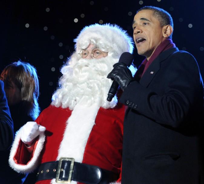 En décembre 2011, Barack Obama et le père No ël chantent ensemble à Washington !