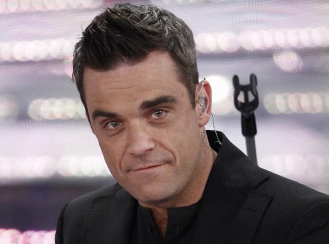 Robbie Williams : son chien récupère après une terrible morsure de serpent !